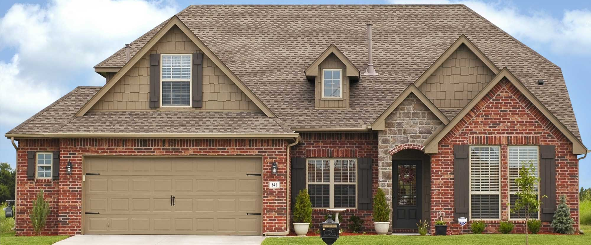 Large brick house with brown trim
